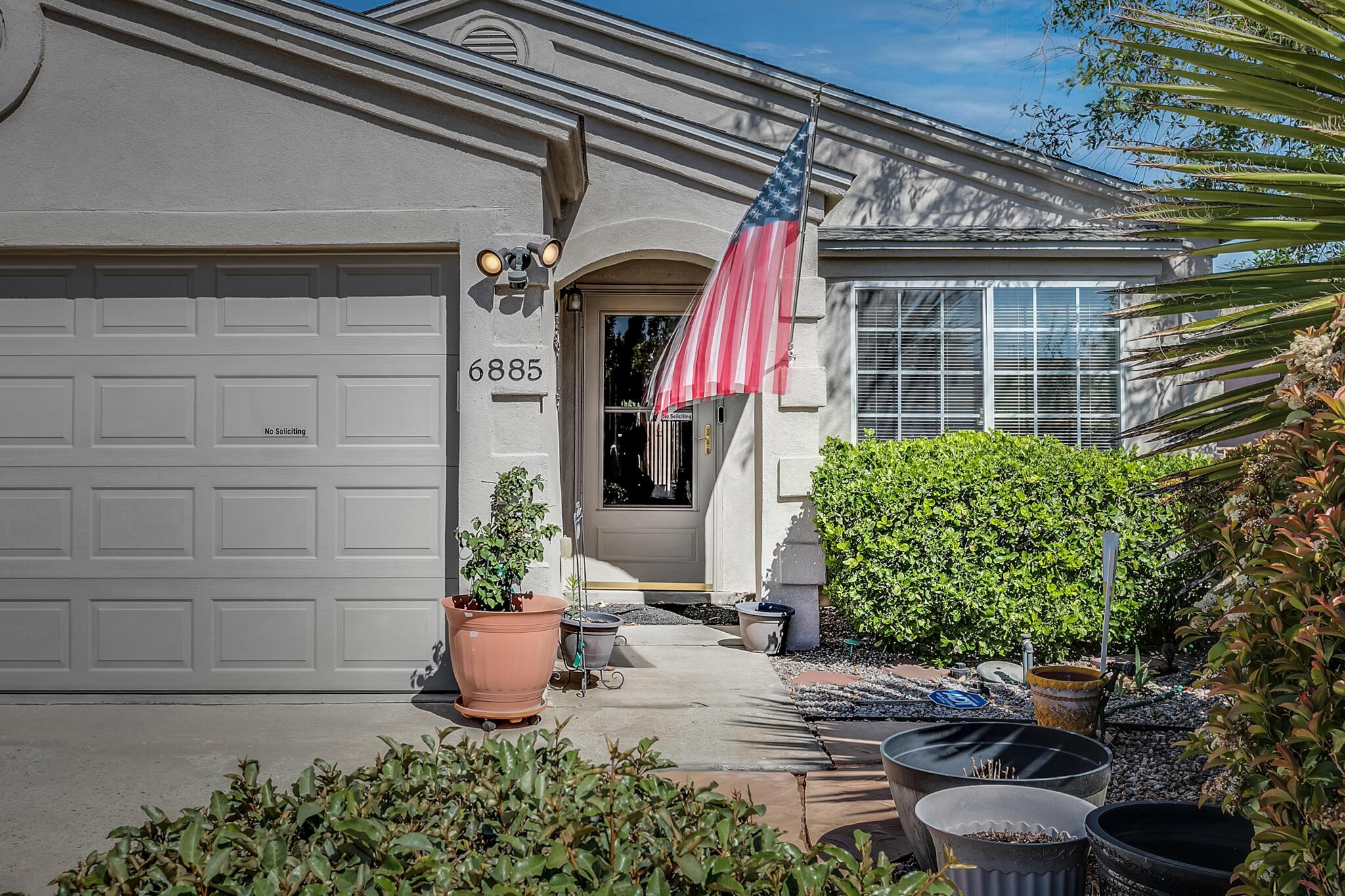 6885 Candelia Avenue Nw Property Photo 1